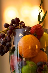 Healthy Snacks - Fruit basket with grapes, oranges and strawberries