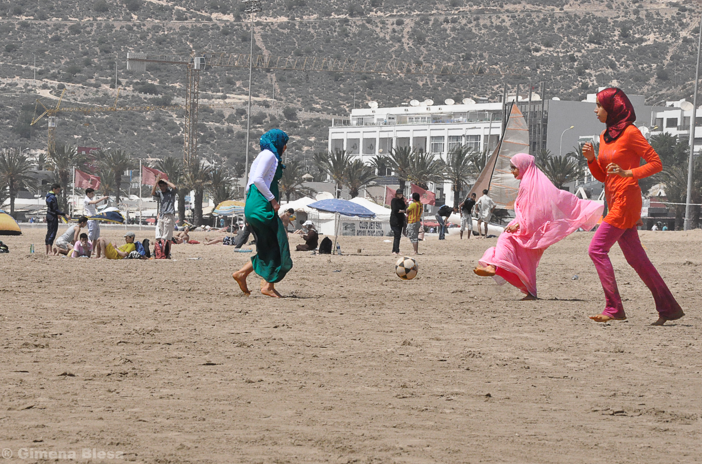 Moroccan girls playing football on the beach, Agadir, Morocco