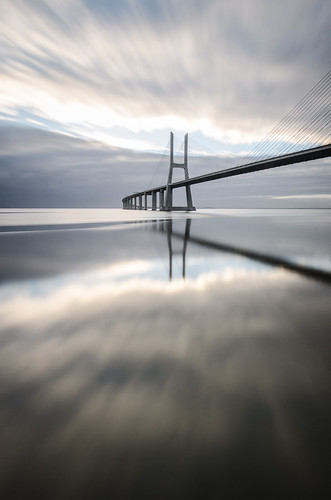 morning travel bridge sky cloud sun motion water sunrise river mirror tide dream suspended distance tagus vascodagama