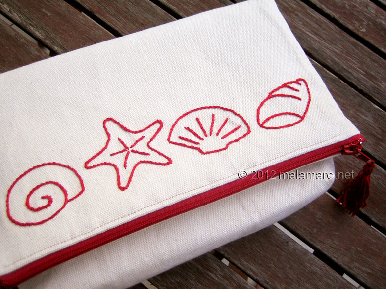 foldover cotton clutch with red hand embroidery fabric