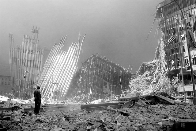A man standing in the rubble calls out asking if anyone needs help, after the collapse of the first World Trade Center tower, by Doug Kanter