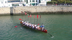 rowing(0.0), canoe sprint(0.0), dragon boat(0.0), vehicle(1.0), sports(1.0), recreation(1.0), outdoor recreation(1.0), watercraft rowing(1.0), boating(1.0), water sport(1.0), watercraft(1.0), canoeing(1.0), boat(1.0), paddle(1.0),