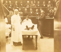 A photo of Dr. Levi Cooper Lane (1828-1902)  in surgical amphitheater over a patient on table with Adolph Barkan (1845-1935) and Richard H. Plummer (1840-1899)