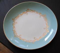 dishware(1.0), platter(1.0), plate(1.0), tableware(1.0), saucer(1.0), porcelain(1.0),