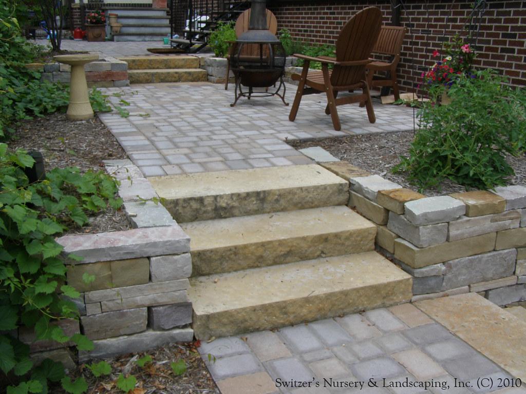 complete backyard renovation kasota natural stone steps and mixed