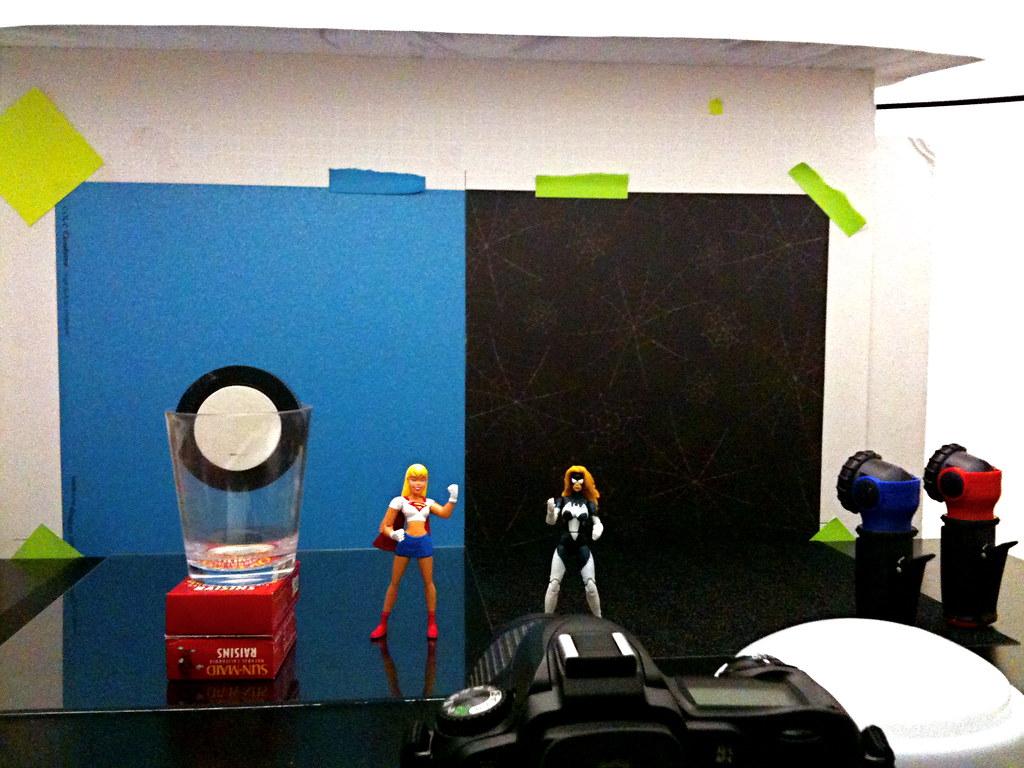 Supergirl vs. Spider-Woman Setup