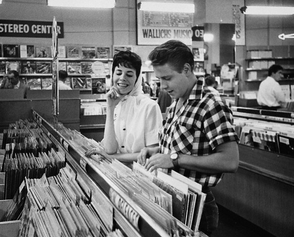 Eddie Cochran and his fiancee, songwriter Sharon Sheeley, shop for records in a Los Angeles music store, by Douglas Kirkland 1959
