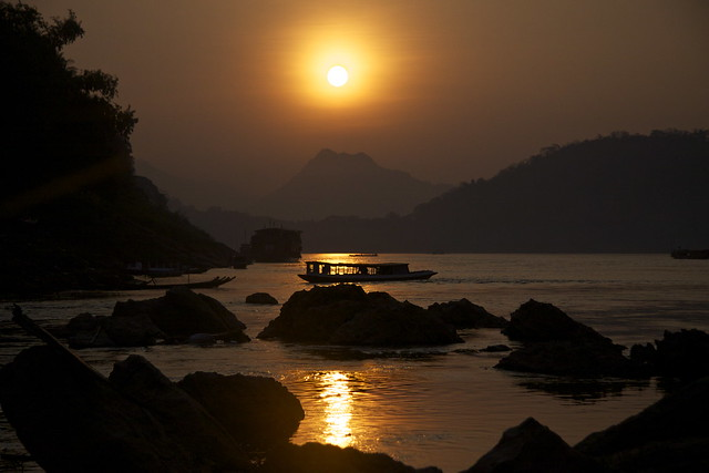 The Sun Setting Over The Mekong In Laos
