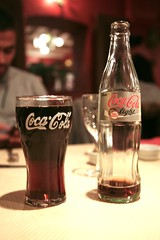 ale(0.0), distilled beverage(0.0), liqueur(0.0), beer bottle(0.0), beer(0.0), alcoholic beverage(0.0), soft drink(1.0), carbonated soft drinks(1.0), bottle(1.0), glass(1.0), drink(1.0), cola(1.0), coca-cola(1.0), pint (us)(1.0),