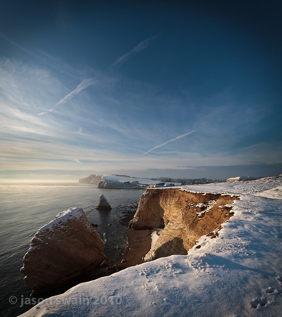 Golden hour in the snow at Freshwater Bay, Isle of Wight.