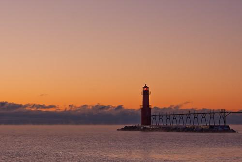 christmas orange lighthouse lake water fog wisconsin sunrise harbor steam lakemichigan breakwater algoma