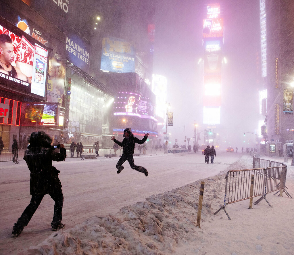 Jumping for joy during New York blizzard, Times Square