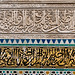 detail of marble carved inscription and tilework - Fes, Morocco