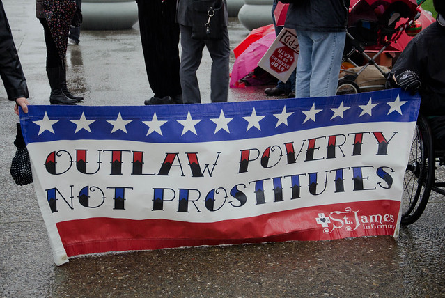 sign reads: outlaw poverty, not prostitutes