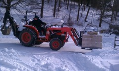 auto racing(0.0), racing(0.0), snow removal(0.0), agricultural machinery(0.0), snow blower(0.0), outdoor power equipment(1.0), winter(1.0), vehicle(1.0), snow(1.0), snowplow(1.0), motorsport(1.0), tractor(1.0),