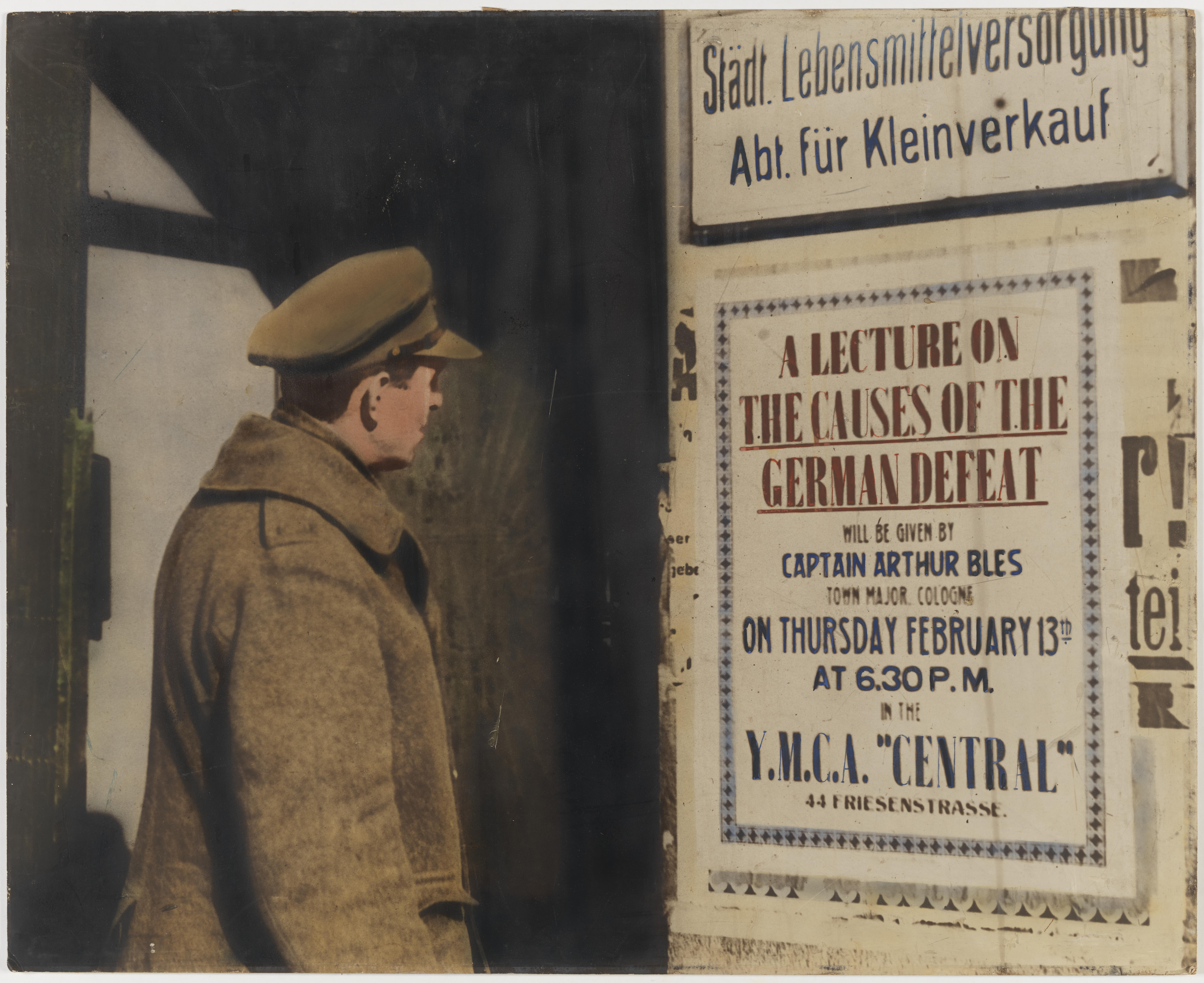 "Soldier looking at billboard: ""Lecture on causes of German defeat.."