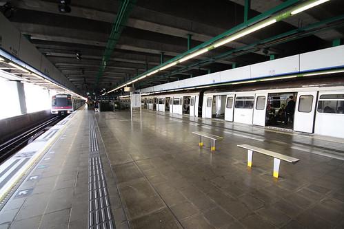 Chai Wan station: train on platform 1 waits for passengers, as a train arrives on platform 2