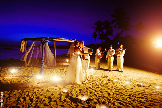 Night candle wedding ceremony at the beach