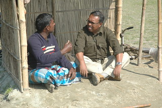 Shykh Seraj talks to a farmer from Kishoreganj haor region