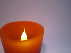 lamp(0.0), light fixture(0.0), ceramic(0.0), orange(1.0), decor(1.0), flameless candle(1.0), candle(1.0), yellow(1.0), lighting(1.0),