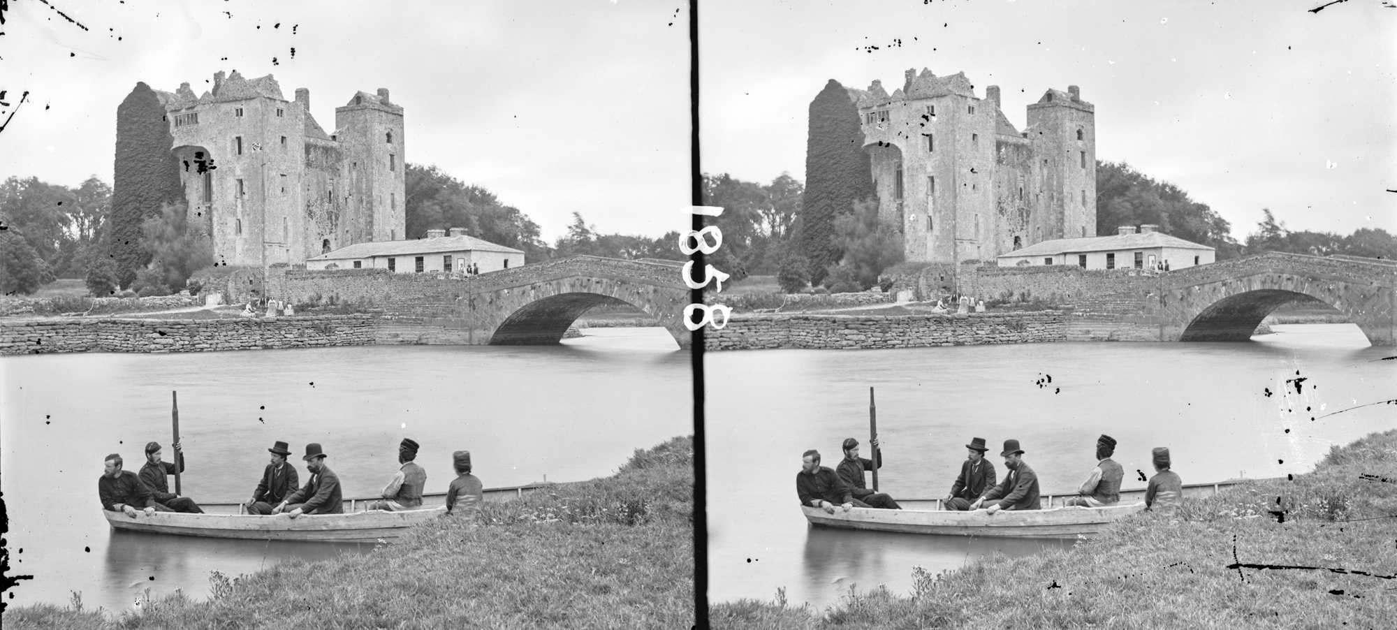 Castle and bridge, row-boat with six people, in foreground, Bunratty, Clare