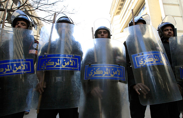 Riot police hold shields in Cairo