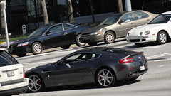 automobile(1.0), aston martin dbs v12(1.0), wheel(1.0), vehicle(1.0), aston martin v8 vantage (2005)(1.0), aston martin virage(1.0), aston martin v8(1.0), aston martin dbs(1.0), aston martin vantage(1.0), performance car(1.0), automotive design(1.0), aston martin vanquish(1.0), aston martin db9(1.0), land vehicle(1.0), luxury vehicle(1.0), coupã©(1.0), supercar(1.0), sports car(1.0),