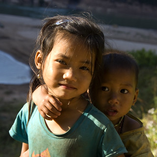 Two small children from the scarf weaving village in Laos