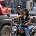 Woman on a motorcycle - Mujer en moto; Joyabaj, El Quiché, Guatemala