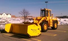compactor(0.0), asphalt(1.0), vehicle(1.0), transport(1.0), construction equipment(1.0), bulldozer(1.0),