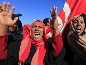 Tunisian women on the frontlines demanding a fundamental change from the neo-colonial RCD regime in their North African country. People attacked a police station in the north of the country on Feb. 6, 2011. by Pan-African News Wire File Photos