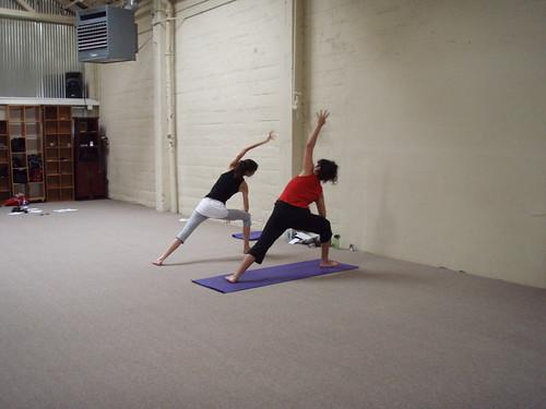 Student teaching Utthita Trikonasana - Extended Triangle