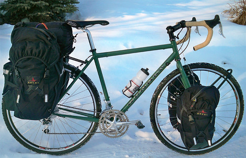 "<p>This Gunnar Grand Tour 54cm in Monetary Green w/Black decals is ready to rock with front and rear panniers from Arkel - as well as Tubus racks.  Photo by Leonard Fancher by Anchorage, AK Feb 2011.  He reports: ""Cool.  Rides very straight.""  60411</p>"