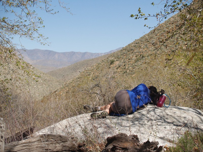 Vicki taking a nap after lunch, near the stream in Indian Canyon