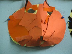carving(0.0), leaf(0.0), wheel(0.0), art(1.0), orange(1.0), art paper(1.0), origami(1.0), paper(1.0), origami paper(1.0), craft(1.0),