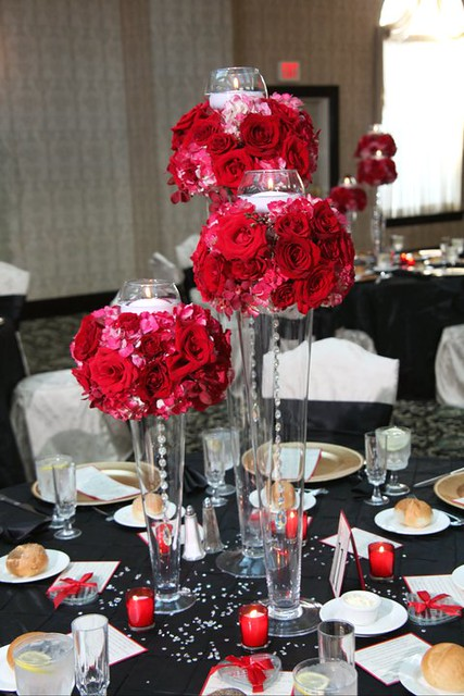 Tall jar centerpieces with red flowers flickr photo