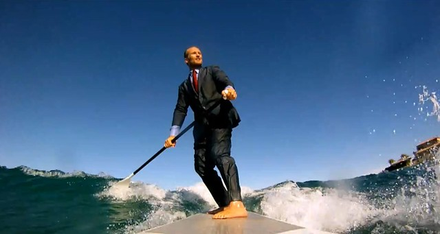 surfing with a suit גולש בחליפה