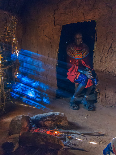 Inside a Samburu home with the wife of a Samburu Chief. She is dressed in her finest native costure and handcrafted jewely. in the Satima - Nalare village