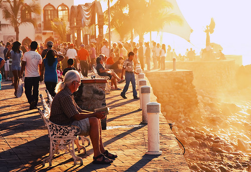 city sunset people beach bench mexico reading book oceanside malecon boardwalk puertovallarta crowds sculptures