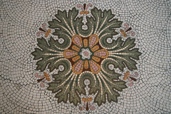 tapestry(0.0), carving(0.0), textile(0.0), needlework(0.0), leaf(0.0), doily(0.0), embroidery(0.0), art(1.0), pattern(1.0), mosaic(1.0), symmetry(1.0), flower(1.0), circle(1.0), flooring(1.0),