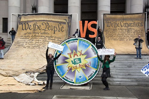 """We The People"" vs ""We The Corporations"" and the ""Wheel of Misfortune"" at Olympia Capital"