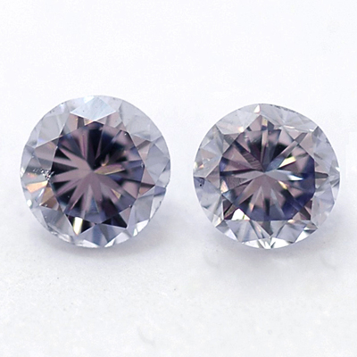 Pair of fancy gray violet, round diamond by Liebish & Co