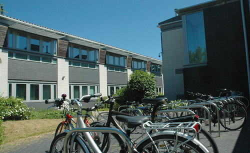 Bicycles secured to metal frames outside S Block, Frenchay Campus.