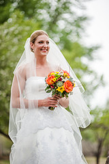 groom(0.0), bride(1.0), veil(1.0), bridal clothing(1.0), bridal veil(1.0), flower(1.0), gown(1.0), wedding(1.0), photograph(1.0), woman(1.0), female(1.0), flower bouquet(1.0), floristry(1.0), wedding dress(1.0), person(1.0), dress(1.0), ceremony(1.0),