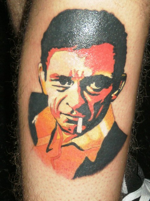Custom designed colored Johnny Cash tattoo