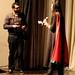 Small photo of Hafsa Shorish presenting gift vouchers