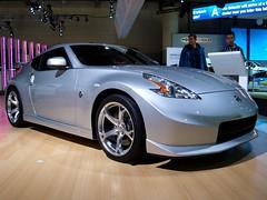 automobile(1.0), automotive exterior(1.0), wheel(1.0), vehicle(1.0), automotive design(1.0), nissan 370z(1.0), nissan(1.0), bumper(1.0), land vehicle(1.0), supercar(1.0), sports car(1.0),