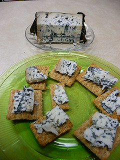 Valdeon Blue Cheese wrapped and aged in oak leaves on a Rosemary Olive Oil Triscuit