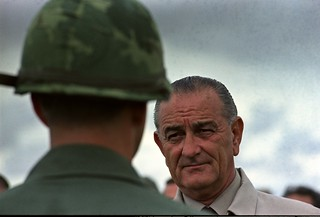 Photograph of President Lyndon Johnson Visiting with U.S. Troops in Cam Ranh Bay, Vietnam, 10/26/1966