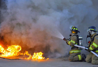 Firefighters attacking a fire